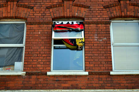 english oak: typical British window in a brick wall with flag