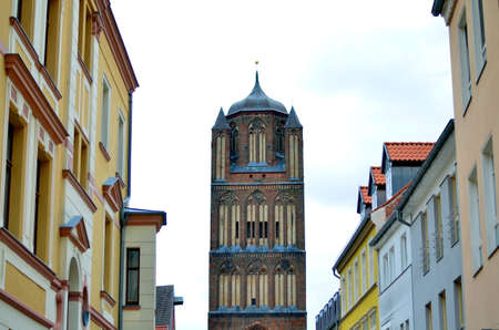 central european: part of large catherdral and cloudy sky in stralsund, germany