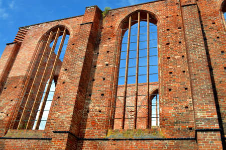 without windows: ruin of an old monastery with blue sky in stralsund, germany Stock Photo