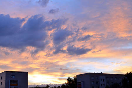 colorful sunset sky with dramatic clouds over berlin