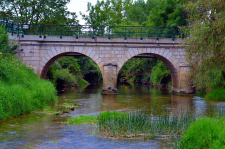 bilding: medieval stone bridge at a river in south france Stock Photo