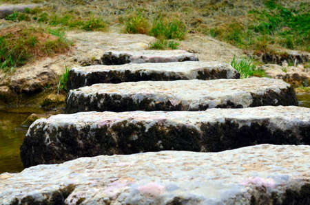 small river: closeup of stepstones crossing a small river Stock Photo