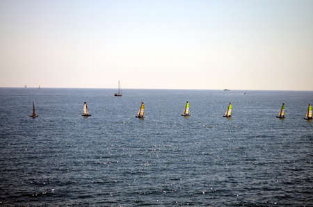 azur: windsurfers in a row on the azur mediterranean sea Stock Photo