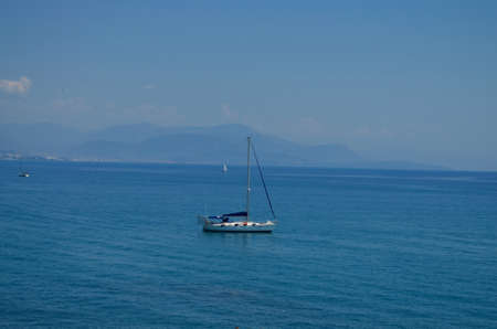 spinnaker: sailing boat on mediterranean sea at french riviera