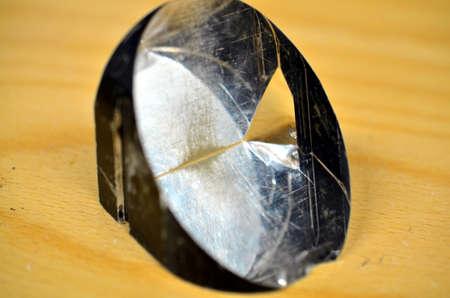 faceting: closeup of polished and transparent quarz prism crystal
