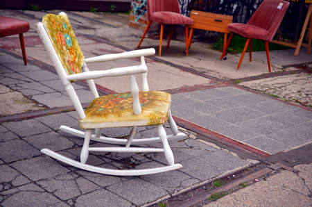rocking chair: white vintage rocking chair on the street