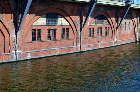 spree: riverside construction bridge with red bricks and arches at spree, Berlin