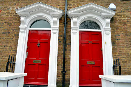 neighbouring: red doors of typical birtish uk building, London Stock Photo