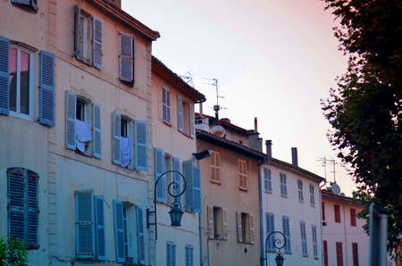 typical south french buildings with shutters during evening sun