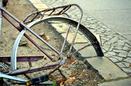 peddle: details of old abandoned rusty and broken bike at the street