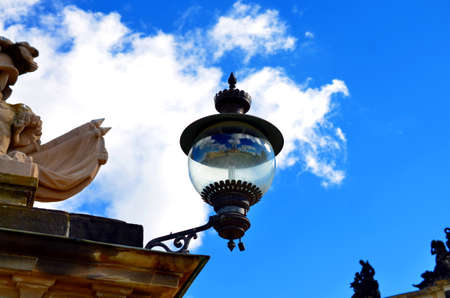 street lantern with reflection and blue sky at park sanssouci, Potsdam, Germany Stock Photo