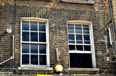 redbrick: two typical British windows in a brick wall opened and closed, Uk, London