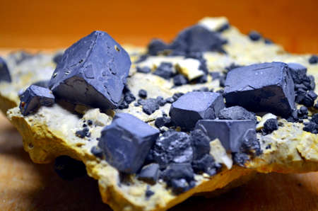 blocky: detail of dark blocky ore minerals on a white rock