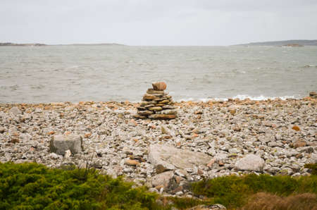 pile of rocks at a windy and rainy coast