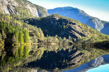 norwegian: perfect reflection of mountains in norwegian fjord Stock Photo
