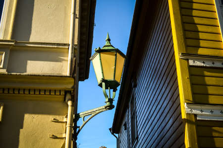 street light hanging on facades in bergen, norway