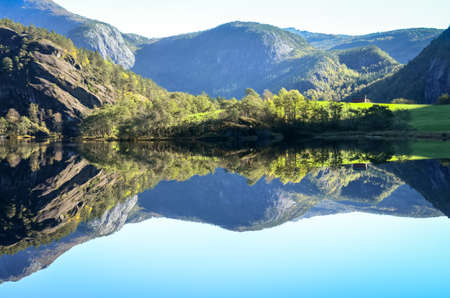 perfect reflection of mountains in fjord water, norway Stock Photo