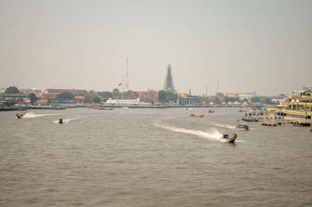 Scenic view of the Chao Praya River in Bangkok, thailand including long tail boat and river taxi