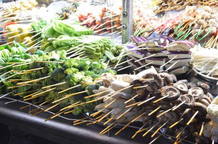 street market: closeup of street food at market in asia Stock Photo