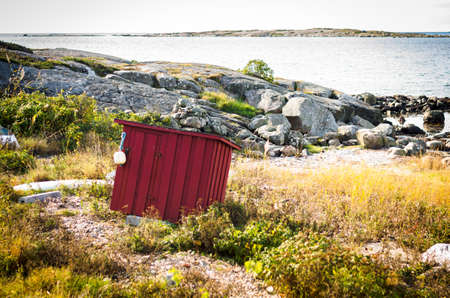 lonely falun red barn at coast of sweden Stock Photo