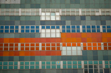 tiles and squares of a facade with repitition color pattern Stock Photo