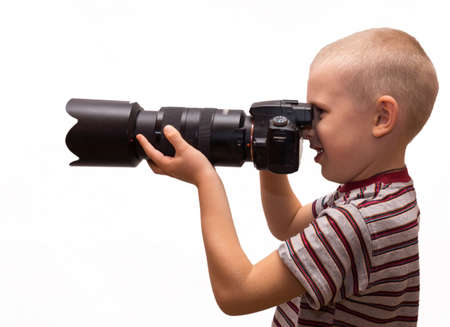 the photograph depicts a child with a camera