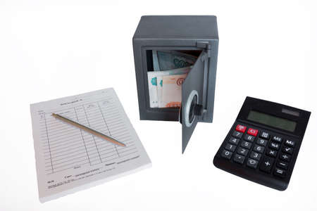 depicts: The photo depicts a safe with money and documents.