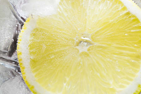 depicts: The photo depicts a lemon in bubbles Stock Photo
