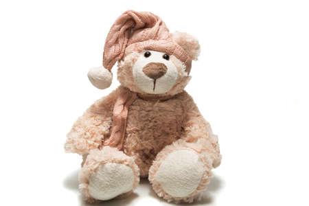 oso de peluche: La foto muestra a un oso de peluche en un casquillo Foto de archivo