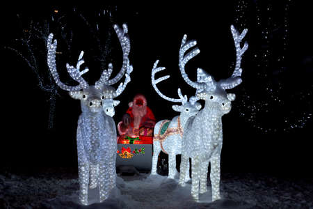 depicts: The photograph depicts Santa Claus in a sleigh