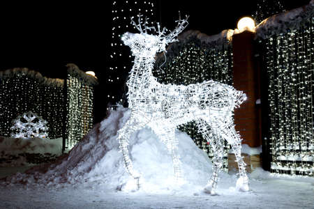 depicts: The photo depicts a Christmas reindeer from light bulbs Stock Photo