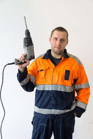 depicts: The photo depicts a worker with hammer Stock Photo