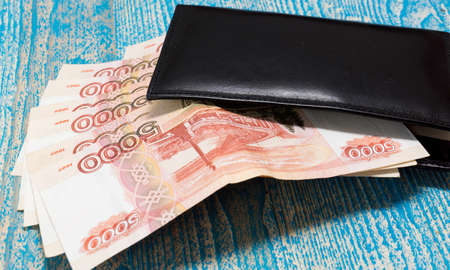 depicts: The photo depicts a purse with money Stock Photo
