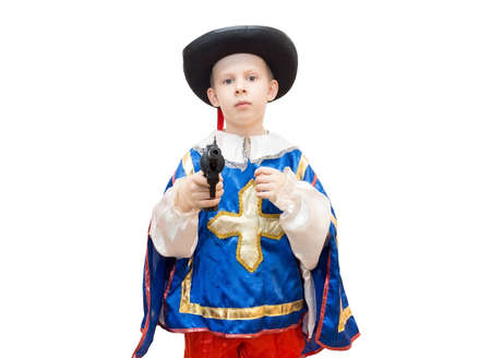 The photo depicts a boy in a suit Musketeers