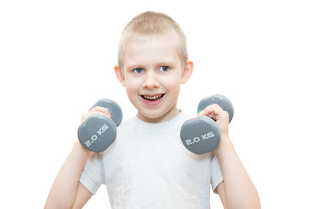 The photo depicts a boy with a dumbbell on a white background