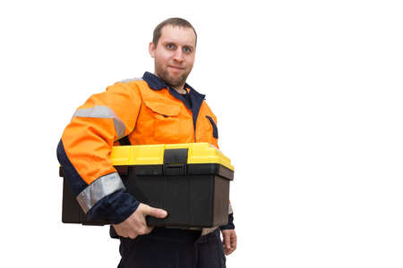 The photo depicts a worker with tool box Stock Photo