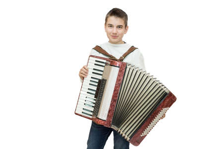 The photo depicts a boy with accordion on a white background