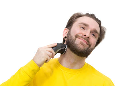 The photo depicts a man shaving beard