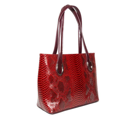 The photograph shows a female handbag on a white background Stock Photo