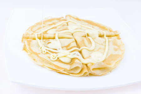 Pancakes drenched with condensed milk on Shrove Tuesday