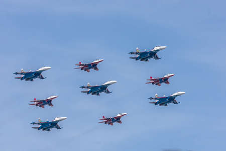 RUSSIA, MOSCOW - may 09, 2015: Parade of aviation technology for military purposes, the Russian Air Force SU-30 and MIG-29 aerobatic groups