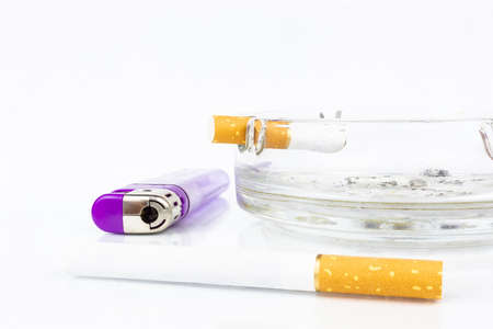 cigarette ashtray lighter and cigarette butt on white background Zdjęcie Seryjne