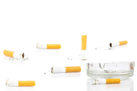 cigarette butt in ashtray on white background, isolated
