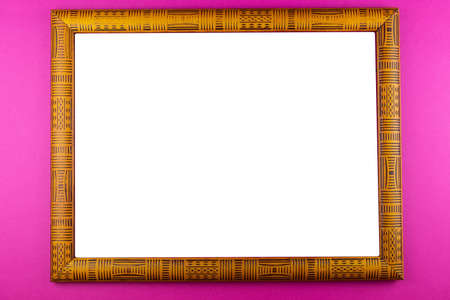 Wooden frame isolated on a pink background Stock Photo