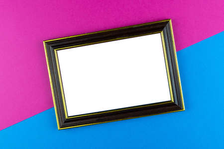 Wooden frame isolated on a blue background