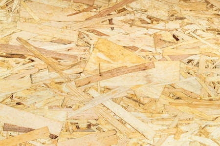 Pressed wooden panel background, seamless texture of oriented strand board