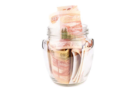 Russian rouble. the money is in a glass jar. five thousand ruble on white background, Bank with money on isolated background