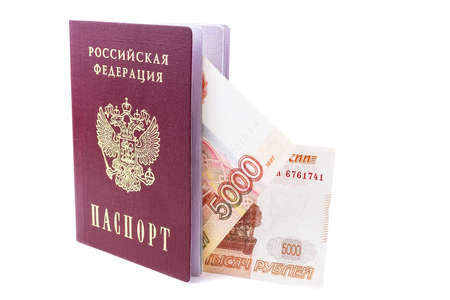 Russian passport with money inside on a white background