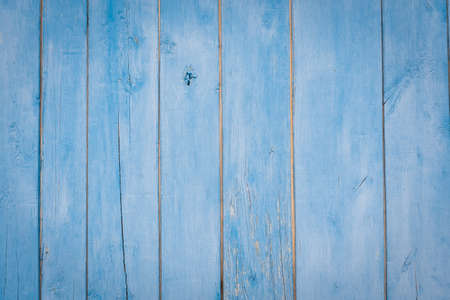 Old grunge wooden fence pattern in navy blue tone. Abstract background and texture for design.