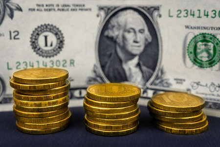 ten-ruble coins and the dollar on a black background, the concept of the ruble's fall